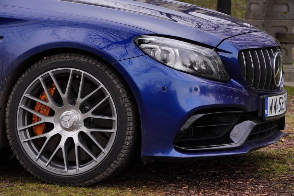 Blue C63 sedan quarter panel and wheel